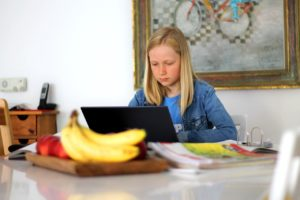 teen girl working on a computer