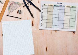 Calendar with schedule and school supplies