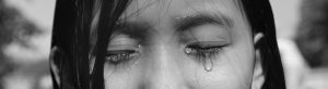 a girl crying tears