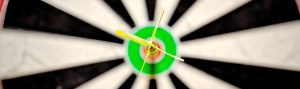 image of dartboard with dart in center perfectionism